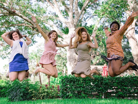 Women's Refuge of Vero Beach residents jump with joy at Artesia's (second from left) graduation.