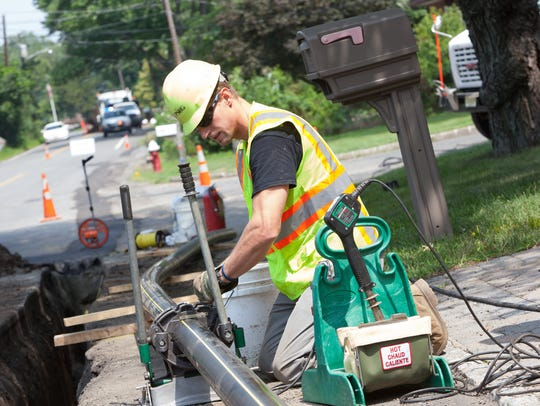 Workers install gas mains in Totowa,