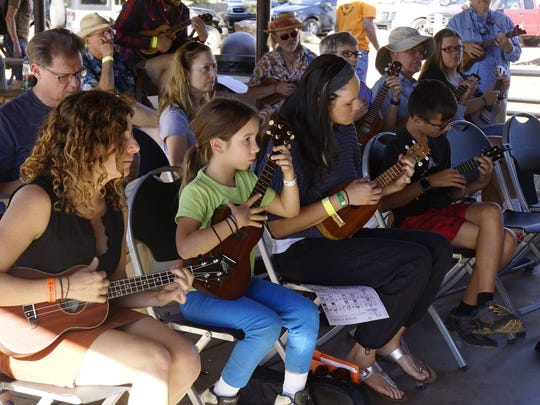Music fans of all ages can take part in instructional workshops at Pickin' in the Pines bluegrass festival in Flagstaff