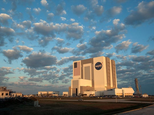 An early morning view of the Vehicle Assembly Building at NASA's Kennedy Space Center, seen in February 2017. To the right is the Launch Control Center. In the background is the mobile launcher.