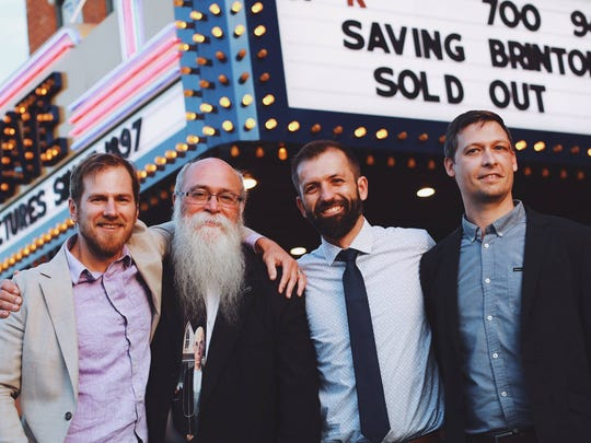 Michael Zahs with his signature beard, flanked by Iowa City filmmakers (from left) Tommy Haines, Andrew Sherburne and John Richard.