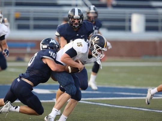 John Phillip Beard makes a tackle in Jackson Academy's