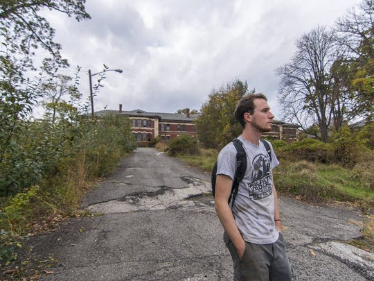 Author Kevin Kowalick ponders on the grounds of the closed Overbrook Hospital in Essex County.