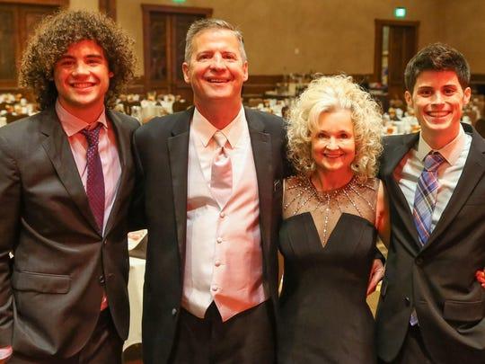 Stephen Kleinsmith and wife, Kari, with sons Jacob,