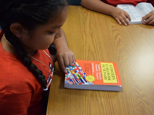 Members of 15 Lee County Rotary Clubs handed out dictionaries