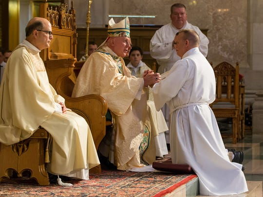 Bishop Daniel E. Thomas celebrates the Ordination of Several Deacons Mass on Sept. 16 at Rosary Cathedral in Toledo.