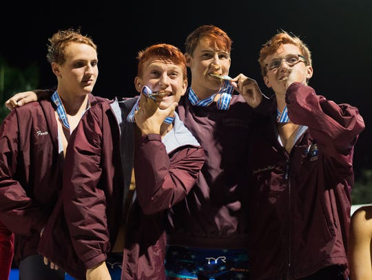 Behind three individual state titles and wins by two