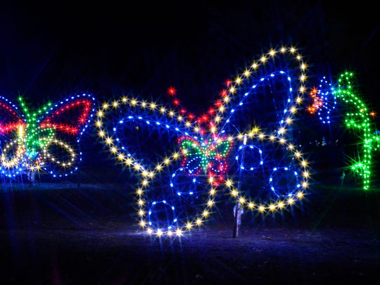 During Wild Lights, lights adorn trees, buildings and more than 230 animal sculptures on a trail through the front half of the Detroit Zoo.