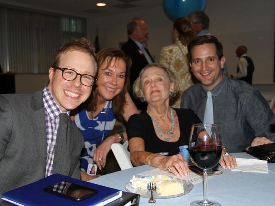 Doris Reynolds at a 90th birthday party thrown in her honor at the Naples Daily News in April 2015. She is surrounded by her grandsons and Naples Daily News Client Strategy Director Robin Lankton.
