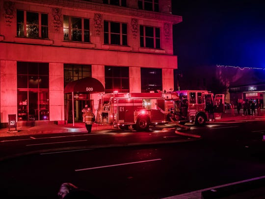 Eight construction workers were evacuated safely Tuesday night after a cutting torch being used burned some wood, causing heavy smoke to emanate from a historic building in downtown Shreveport, Fire Department Assistant to the Chief Fred Sanders said.