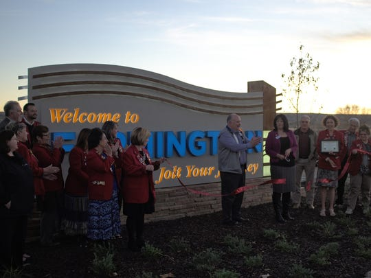 Ribbon cutting at the Welcome to Farmington monument located on the West side of Farmington on Hwy 64.