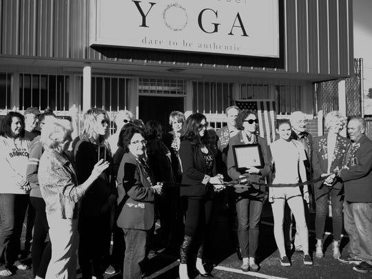 Ribbon cutting at Sacred Rebel Yoga located at 2010 E. 19th St.