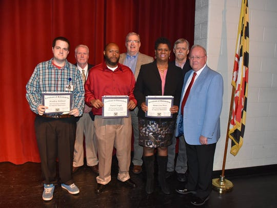 Certificates of achievement went to the members of the custodial staff at Pittsville Elementary and Middle School for earning a 2017 Governor's Citation for Superior Maintenance of Schools: Mona Lisa Price, building service manager, and custodians Dan Teagle, Dwayne Williams, Bradley Millman, Patsy Purnell, Kathy Chartrand.