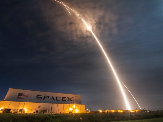 On July 18, 2016, a SpaceX Falcon 9 rocket launched a Dragon cargo capsule from Launch Complex 40 at Cape Canaveral Air Force Station to the International Space Station. The rocket booster returned to the Cape for landing. In the foreground is SpaceX's hangar at Kennedy Space Center.