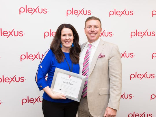Sarah Tasa, pictured with Tarl Robinson, CEO of Plexus