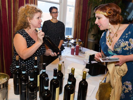 Looking at wine at the 2017 Shakespeare Uncorked event.