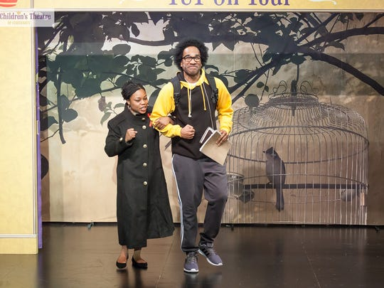 "Brandi Langford-Sherrill (left) plays the title role of Dr. Maya Angelou in ""Maya Angelou: A Writer's Legacy,"" performed by TCT On Tour, the touring arm of The Children's Theatre of Cincinnati. She is seen here with Ryan-Chavez Richmond, one of the show's three other cast members."