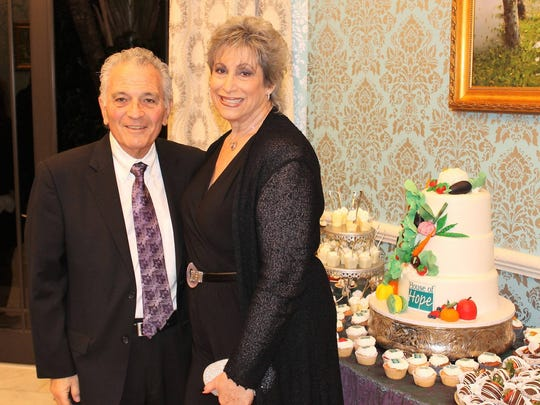 David Reback and Maxine Noel at the private fundraiser thrown by Dr. Daniel and Marlena Hustedat theirhome Feb. 24.