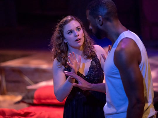 "Though the play is 415 years old, the betrayal, distrust and racial complications of ""Othello"" make it ""a truly modern play,"" says Brant Russell, who teaches playwriting at the College-Conservatory of Music."" Seen here are William Watkins as Othello and Courtney Lucien as Desdemona in the Cincinnati Shakespeare Company production that closes March 24."