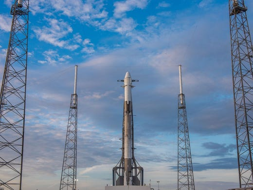 A SpaceX Falcon 9 rocket sits on the pad at Cape Canaveral