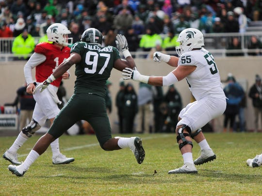 Michigan State defensive end Justice Alexander is late reaching QB Brian Lewerke during the Spartans' Green-White spring football game, Saturday, April 7, 2018.