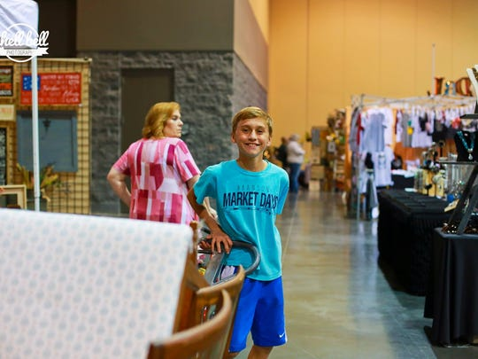 "Kyeden Goodwin, a family member of the show owners, is a 13-year-old porter at Branson Market Days. This ""eclectic vendor show"" returns to Branson Convention Center May 11-12, 2018."