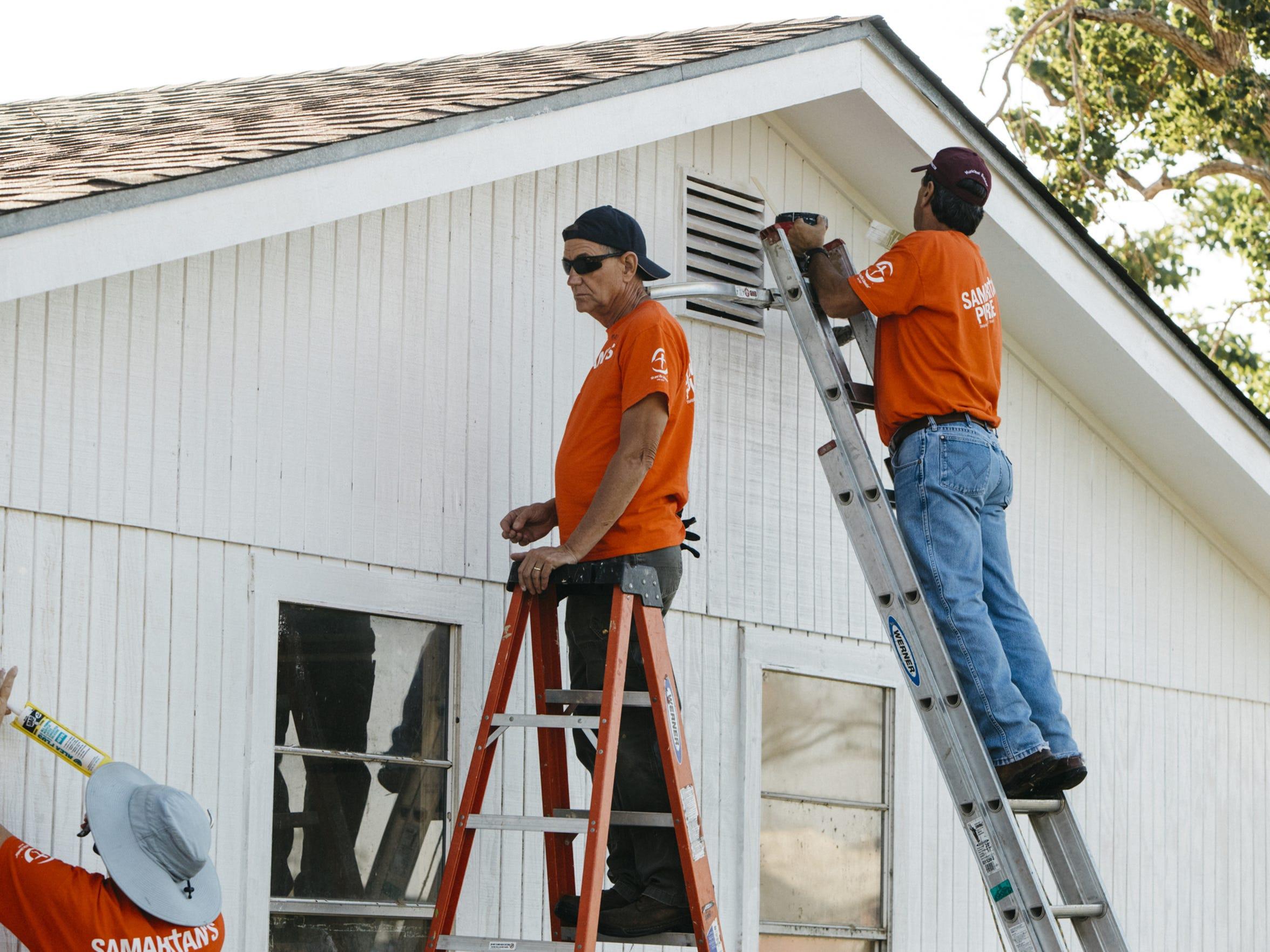 Volunteers work in Rockport to make repairs after Hurricane