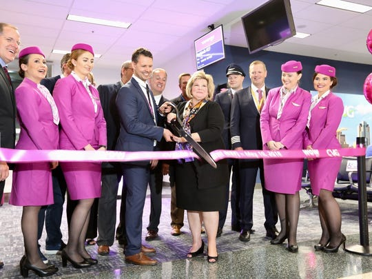 CVG and WOW Air representatives cut a ribbon at gate B9 for the inaugural WOW flight to Iceland.