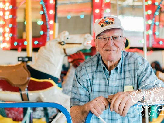 Harry Benjamin poses for a photo with the Carousel