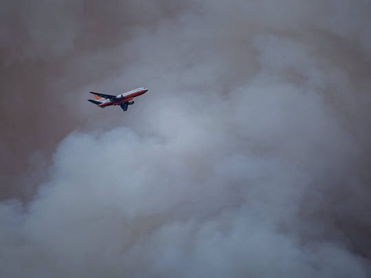 An air tanker made its way to Mescalero after a wildfire