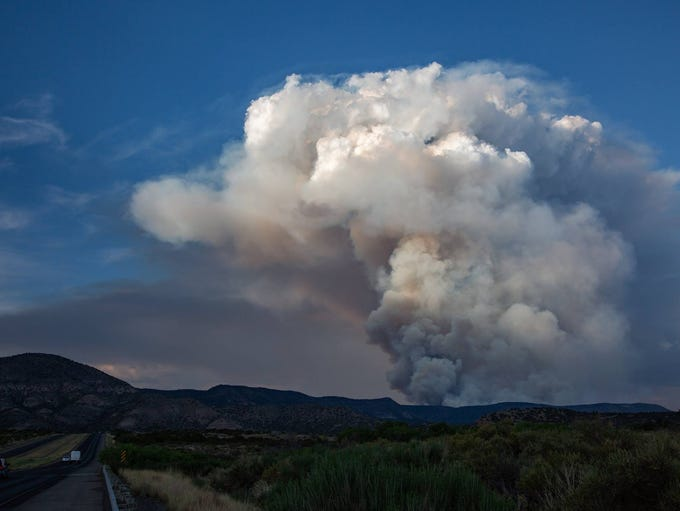 A large plume of smoke hovers over the Mescalero Apache