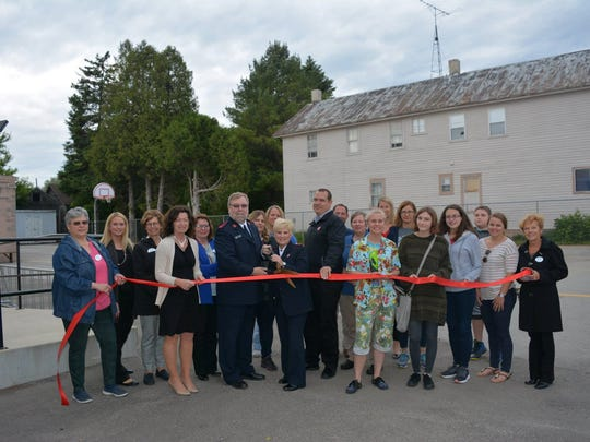 Salvation Army Manitowoc County recently celebrated completion of a lighted basketball court at The Light Teen Center, 402 N. Ninth St.