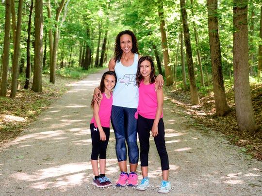 Wayne County native Davina McNaney, 45, with daughters