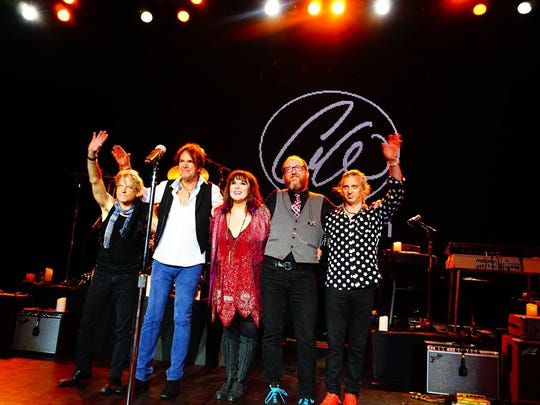 Ann Wilson is flanked by her touring band (from left),