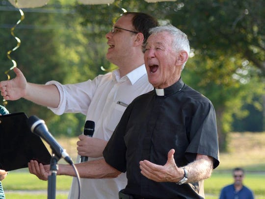 Andrew Ballew and Fr. Michael Woods at his 50-year