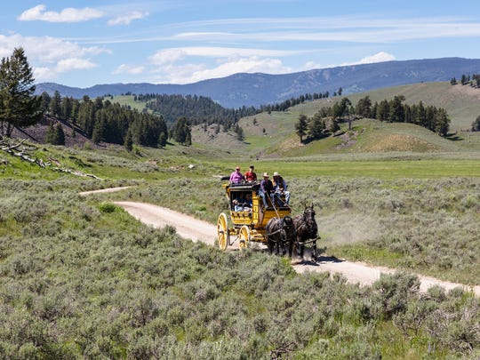 Wagon arriving at Tower Junction in Yellowstone National
