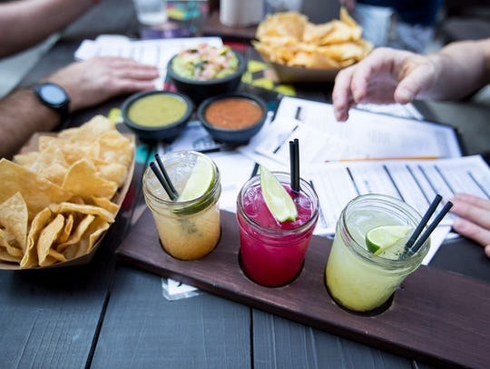 Try lots of margarita flavors by order flights at Condado