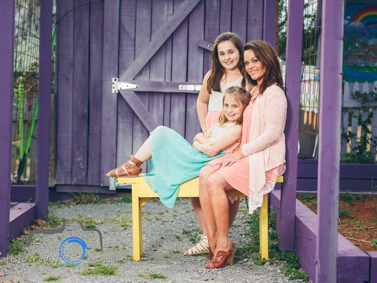 Angelique Diedrick, right, with her two daughters Aubrie,
