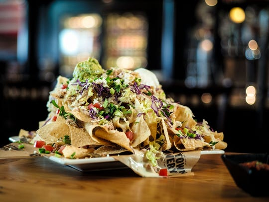 """Bricktown Brewery serves a variety of American pub foods """"with a twist,"""" in the words of its CEO, including """"chipped chopped nachos."""""""