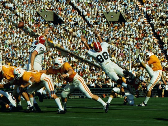 Tennessee kicker Karl Kremser kicks the extra point after his holder, Mike Jones (40), scored the first points of the game on a 2-yard touchdown run against SEC foe Georgia on Sept. 14, 1968, at Neyland Stadium.