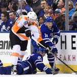Rielly, Hyman lead Maple Leafs past Flyers, 6-3