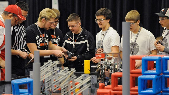 Teams concentrate while competing in the VEX Robotics state tournament in January 2015 at the River's Edge Convention Center in St. Cloud.