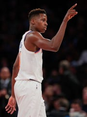 New York Knicks guard Frank Ntilikina (11) motions to center Kyle O'Quinn during the second quarter of an NBA basketball game against the Brooklyn Nets, Friday, Oct. 27, 2017, in New York.