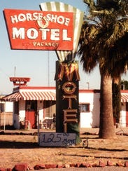 A neon sign from Casa Grande's Horseshoe Motel will