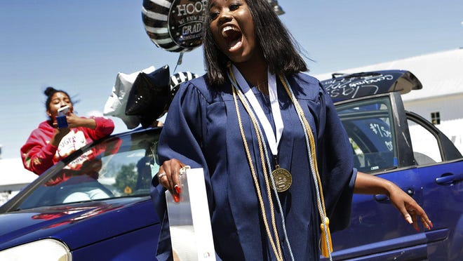 Terriona Watkins expresses her surprise upon receiving a new laptop at her graduation ceremony from KIPP Sunday, May 31, 2020. This is the first graduating class for KIPP, a Columbus Charter School. Each graduate received a new laptop as a surprise.