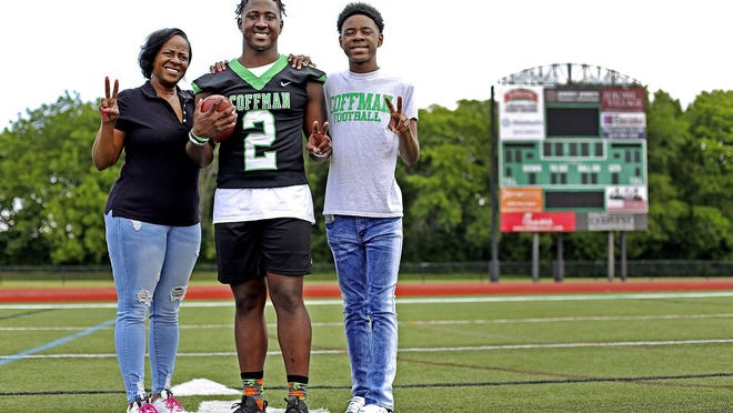 Bryon Threats, center, who will be a senior this fall at Dublin Coffman, is flanked by his mother, Sharon Wilkins, and his younger brother, Terry Allen. Threats was shot twice in 2017 in gang-type activity. His mother relinquished guardianship to an old friend so Bryon could move to Dublin and escape that lifestyle.