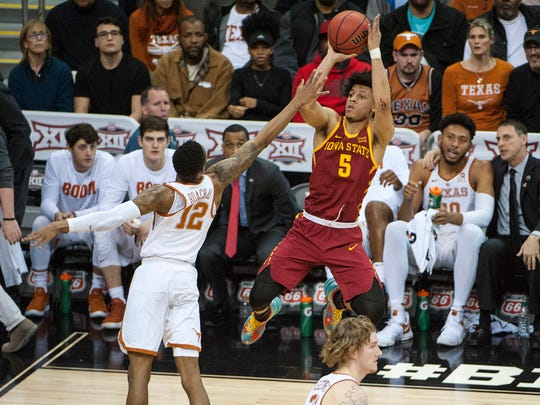 Iowa State guard Lindell Wigginton shoots over Texas Longhorns guard Kerwin Roach II during their game in the first round of the Big 12 Tournament at Sprint Center on March 7, 2018, in Kansas City, Missouri.