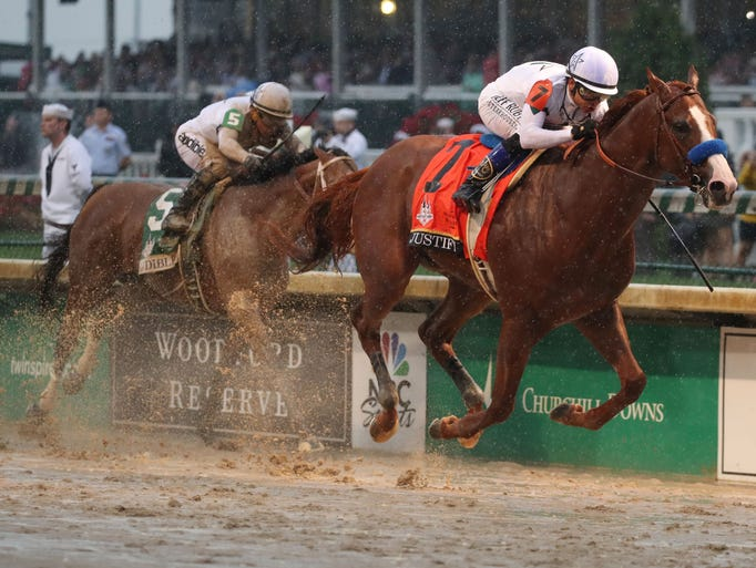 Justify, ridden by Mike Smith, beats Audible (5) to