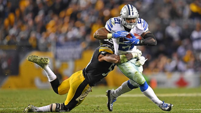 PITTSBURGH, PA - NOVEMBER 13:  Ezekiel Elliott #21 of the Dallas Cowboys rushes against Ryan Shazier #50 of the Pittsburgh Steelers in the second half during the game at Heinz Field on November 13, 2016 in Pittsburgh, Pennsylvania. (Photo by Joe Sargent/Getty Images) ORG XMIT: 663936503 ORIG FILE ID: 623050244