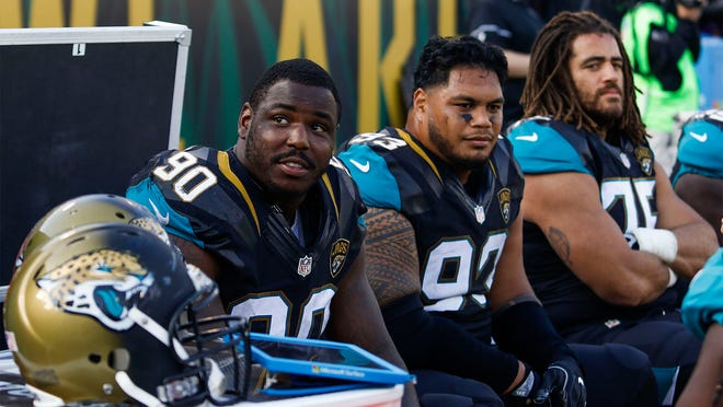 Nov 13, 2016; Jacksonville, FL, USA;  Jacksonville Jaguars defensive tackle Malik Jackson (90) looks on from the bench during a game against the Houston Texans at EverBank Field. Houston Texans won 24-21.  Mandatory Credit: Logan Bowles-USA TODAY Sports